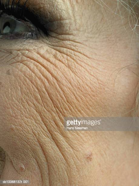 close up of senior woman's cheek - wrinkled stock pictures, royalty-free photos & images