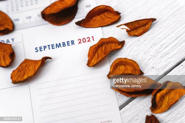 close up of september 2021 calendar - september stock-fotos und bilder