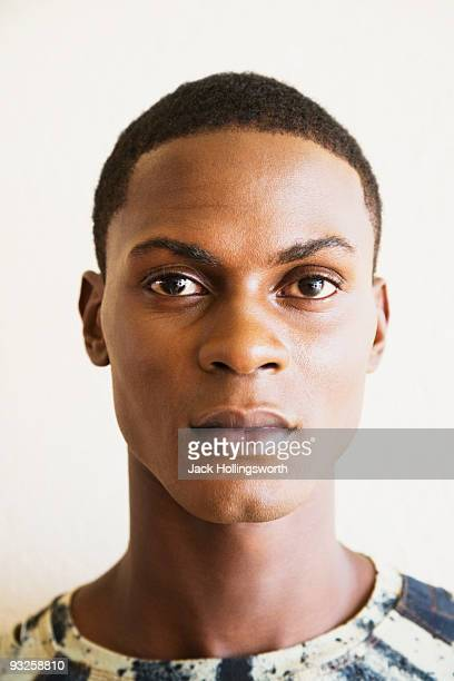 close up of serious african man - androgynous stock pictures, royalty-free photos & images