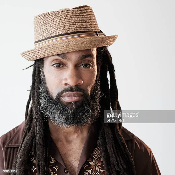 Close up of serious Black man with dreadlocks