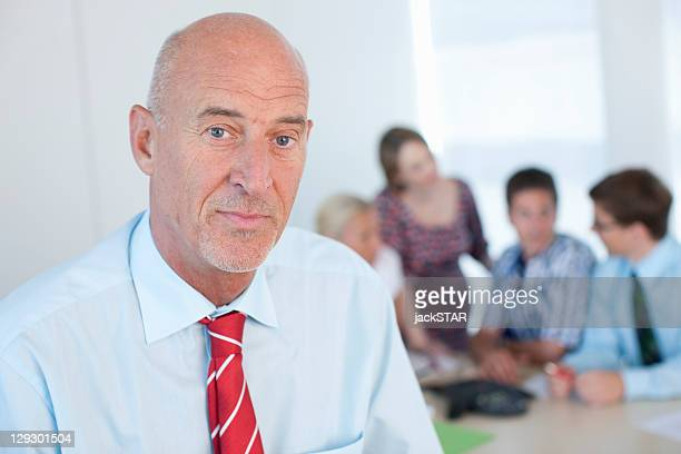close up of serious businessmanãs face - 50 59 years stock pictures, royalty-free photos & images