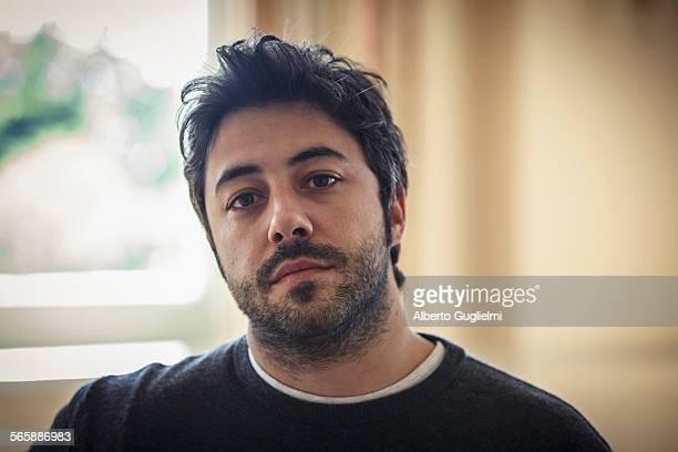 Close up of serious Caucasian man indoors