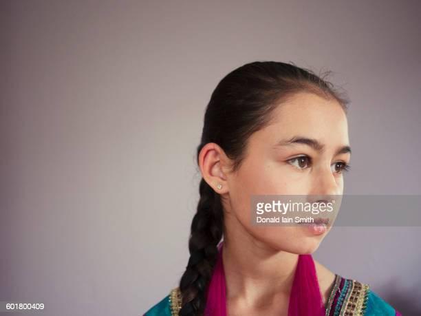 close up of serious mixed race girl - punjabi girls images stock photos and pictures