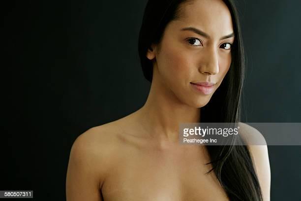 Close up of serious nude mixed race woman