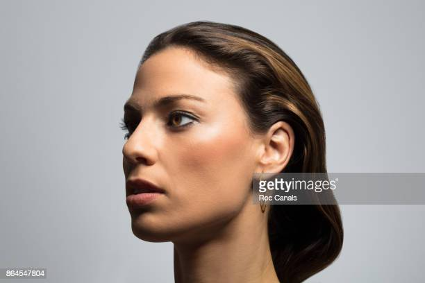 close up of serious woman - profile stock pictures, royalty-free photos & images