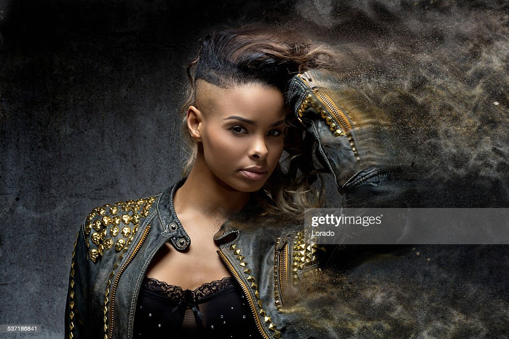 close up of shaved black woman wearing leather jacket : Stock Photo