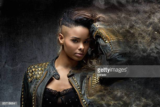 close up of shaved black woman wearing leather jacket