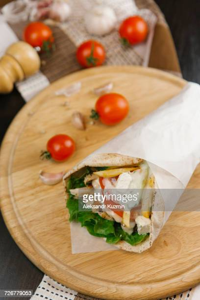 Close up of shawarma wrap on cutting board