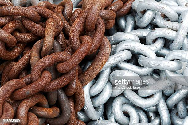 Close up of shiny and rusted metal chains