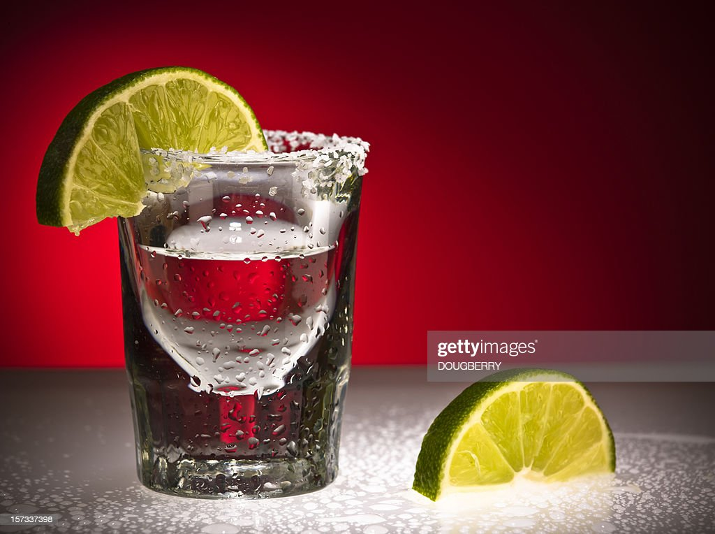Close up Of Shot Glass and Limes : Stock Photo