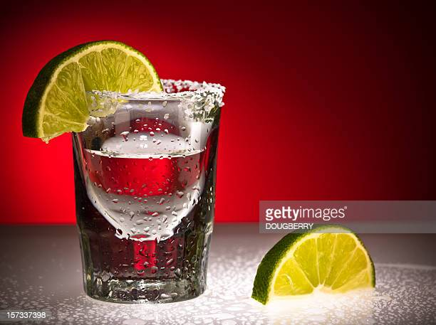 Close up Of Shot Glass and Limes