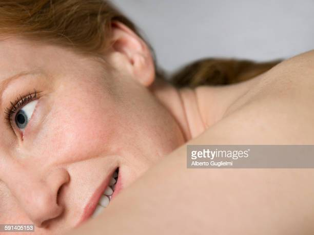 Close up of shoulder and face of nude Caucasian woman