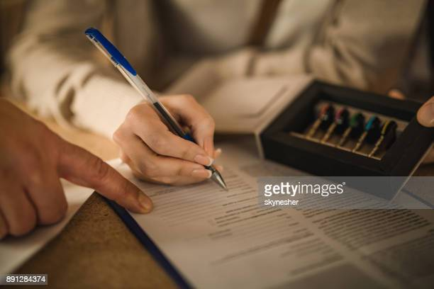 Close up of signing a contract for a new house.