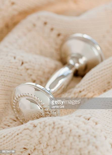 Close up of silver baby rattle