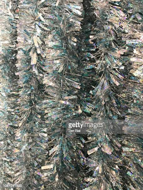 close up of silver colored tinsel - tinsel stock pictures, royalty-free photos & images