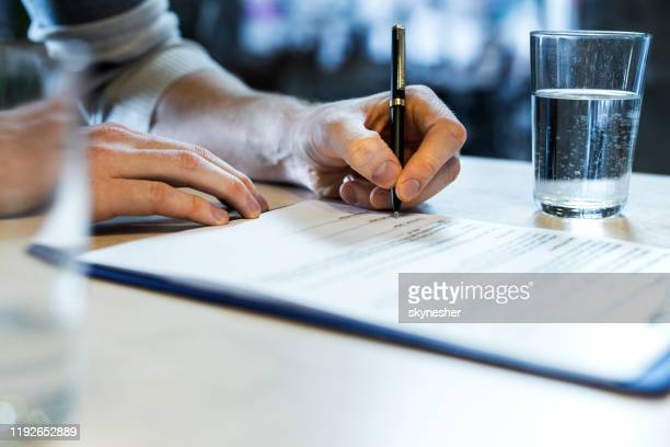 close up of singing a contract! - signing stock pictures, royalty-free photos & images