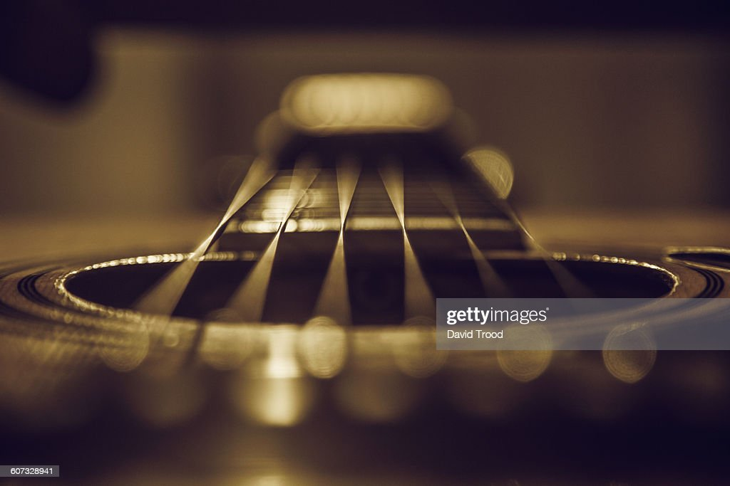 Close up of six string acoustic guitar : Stock Photo