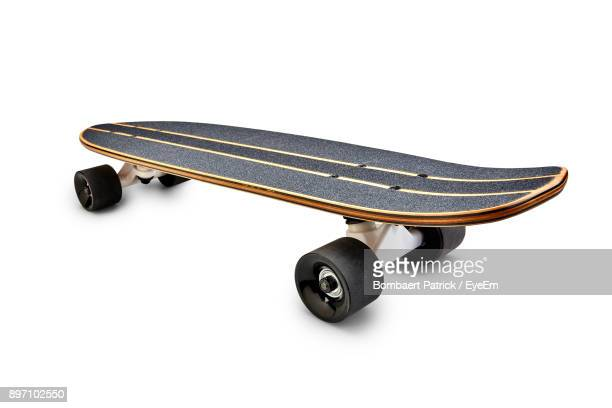 Close Up Of Skateboard Over White Background
