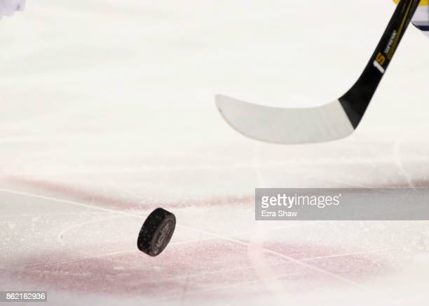 Close up of skates and the puck during the San Jose Sharks game against the Buffalo Sabres at SAP Center on October 12, 2017 in San Jose, California.
