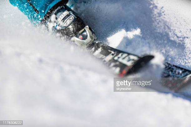 close up of skiing on snow. - downhill skiing stock pictures, royalty-free photos & images