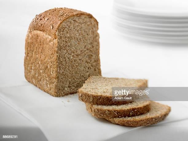 Close up of sliced loaf of fresh bread