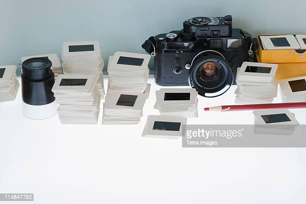 close up of slides and camera on light box - dia stock-fotos und bilder