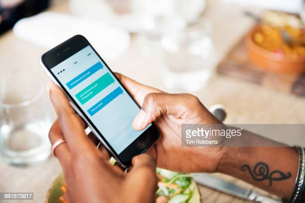 close up of smart phone at lunch. - sms'en stockfoto's en -beelden