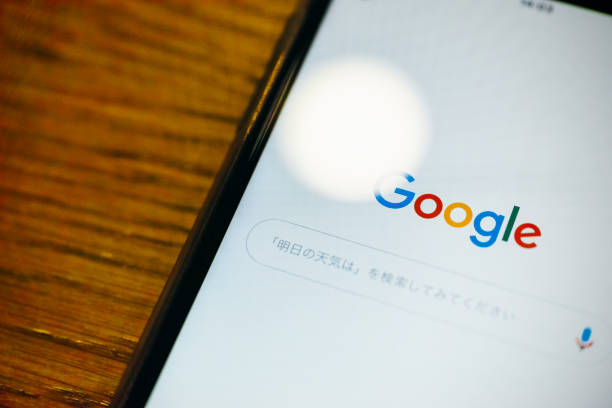 Close up of smartphone screen with google logo