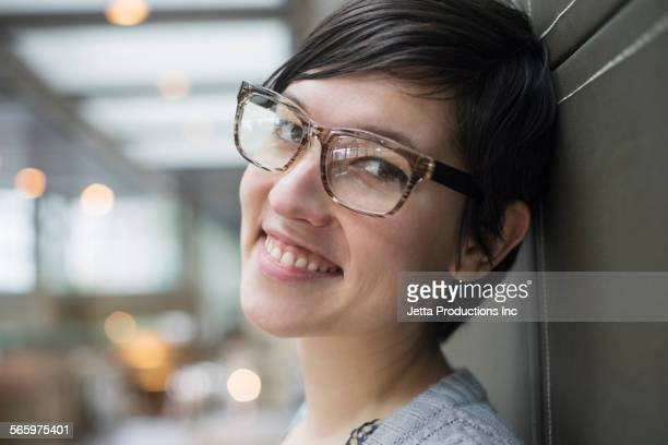 Close up of smiling Caucasian woman wearing eyeglasses