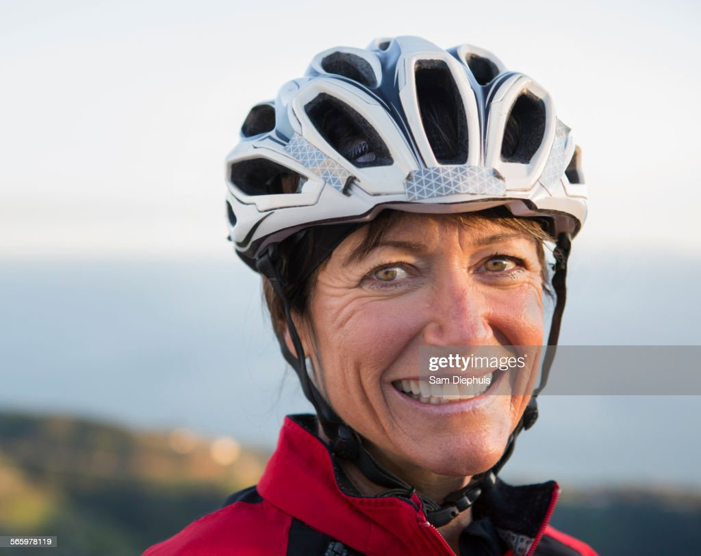 Close up of smiling Caucasian woman wearing helmet : Stock Photo