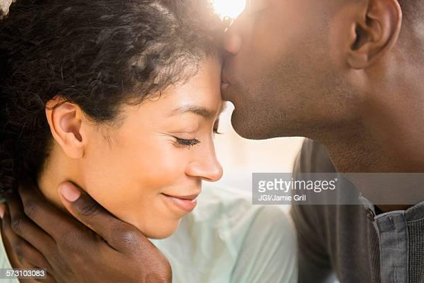 close up of smiling couple kissing - miscigenado imagens e fotografias de stock