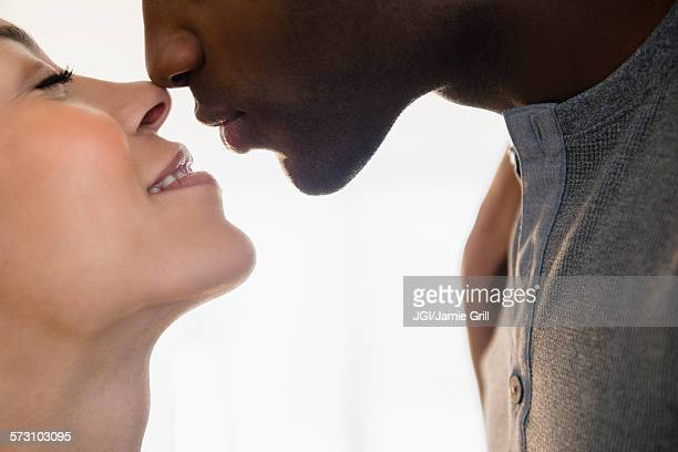 close up of smiling couple kissing - black people kissing stock pictures, royalty-free photos & images