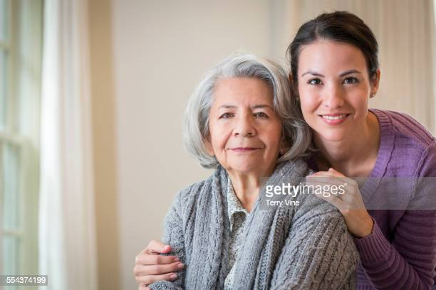 close up of smiling daughter hugging mother - fragility stock pictures, royalty-free photos & images