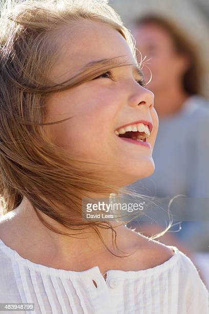 Close up of smiling girl (7-8) outdoors