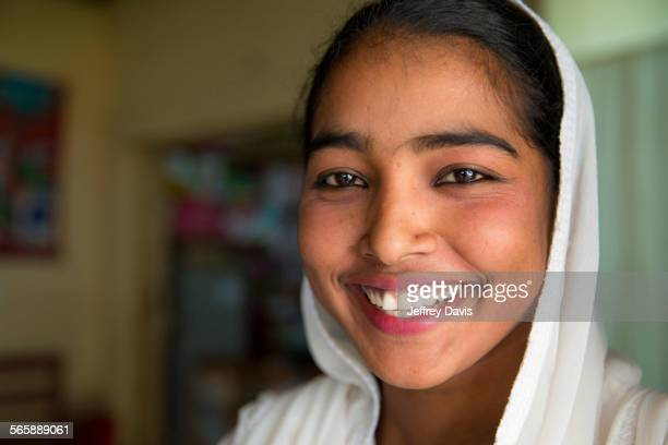 close up of smiling girl wearing headscarf - bangladeshi beautiful girl stock photos and pictures
