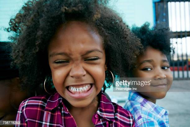 close up of smiling girls - funny black girl stock photos and pictures