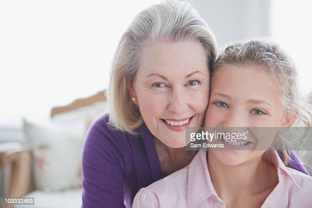 Close up of smiling grandmother and granddaughter