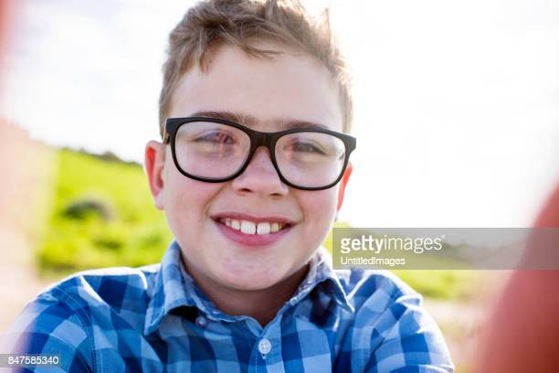 close up of smiling happy boy - human age stock photos and pictures