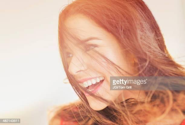 Close up of smiling Hispanic woman