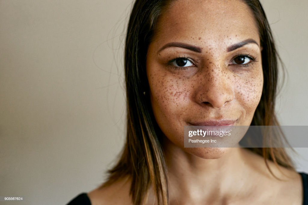 Close up of smiling mixed race woman : Stock Photo