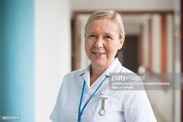 close up of smiling nurse in  hospital corridor