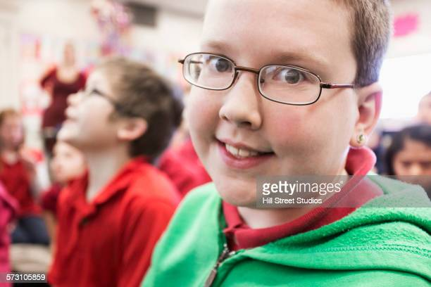 close up of smiling student in classroom - chubby boy - fotografias e filmes do acervo