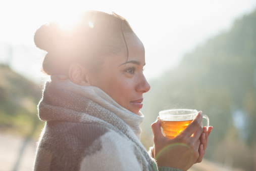 Close up of smiling woman drinking tea outdoors - gettyimageskorea