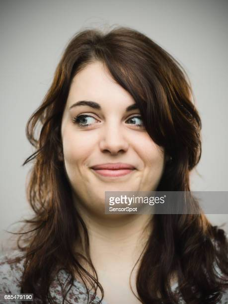 Close up of smiling woman looking away