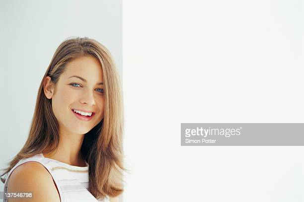 close up of smiling womans face - one young woman only stock pictures, royalty-free photos & images