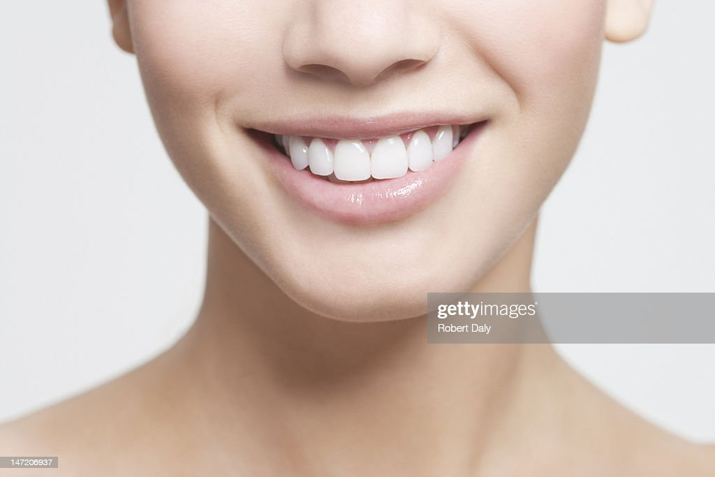 Close up of smiling woman's mouth : Bildbanksbilder