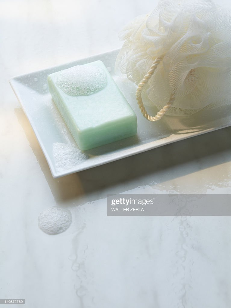 Close up of soap and loofah : Stock Photo