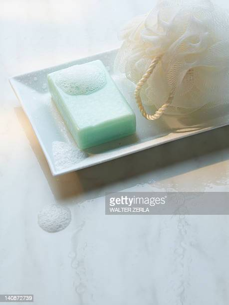 close up of soap and loofah - loofah stock photos and pictures
