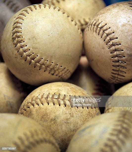 Close up of softballs waiting to be used in a game