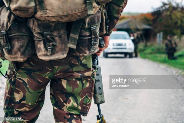 close up of soldier holding assault rifle - army soldier stock pictures, royalty-free photos & images